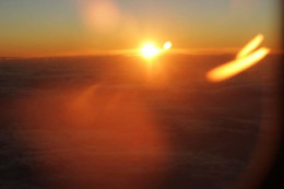 This photo was taken from an airplane at 30,000 feet clearly showing a second sun.