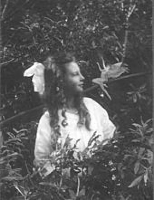 Frances Griffiths looking at a leaping fairy.