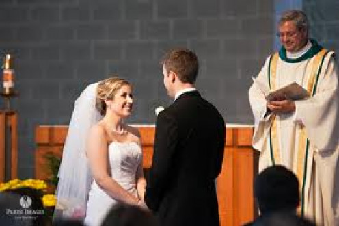 A couple gets married in church