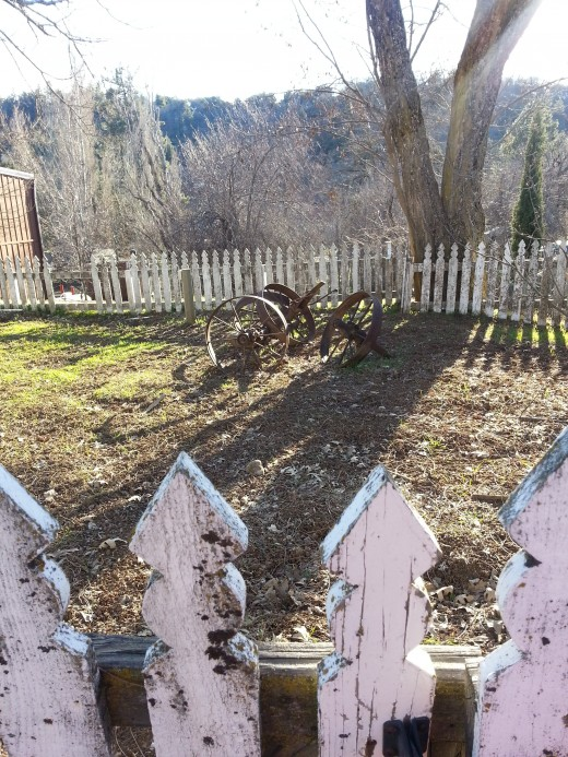 Early farm equipment dot the landscape in Julian