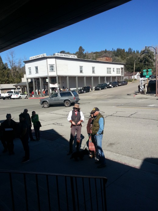"""The """"Law"""" in Julian. Street performers walk the downtown in Julian as they did in the early days."""