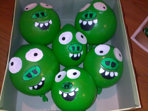 Blow up the balloons and glue on faces.