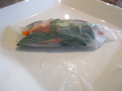 Carefully fold the rice paper over the fillings.