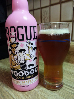 Poured pint of Rogue Voodoo Doughnut Bacon Maple Ale