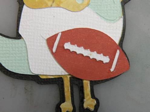 Football adhered to card