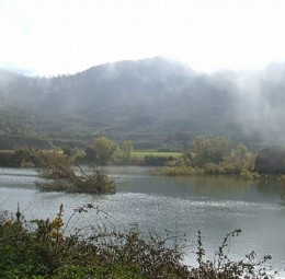 One of the ponds of Erjos with mist rising over the water