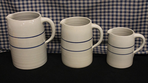 Stoneware pitchers come in several styles colors, and sizes.