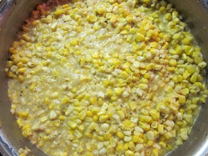 Corn and ingredients in fry pan