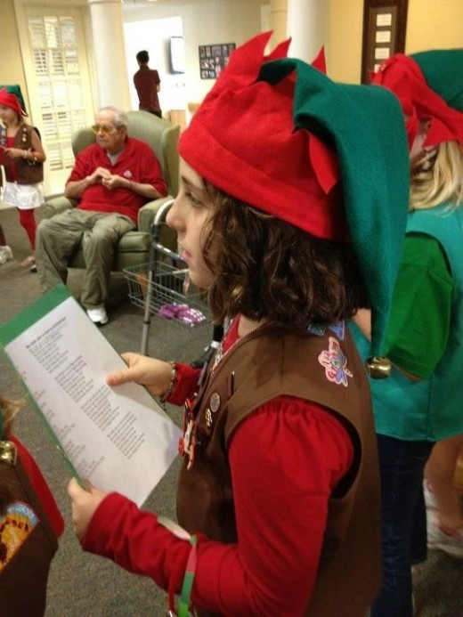 Caroling at a nursing home with Brownies.