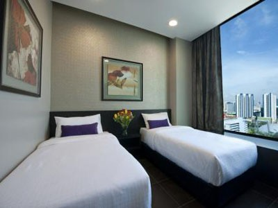 "V Hotel Lavender Twin Room - comes with 32"" LCD, Wi-Fi Internet access, safe deposit box, complimentary toiletries and beverages."