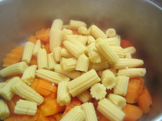 Add baby corns and 1 tablespoon olive oil (optional). Season with salt and pepper.