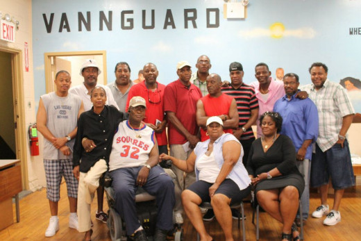Youth Council Director Kelvin Hicks and his Vannguard Urban Improvement Center co-workers.