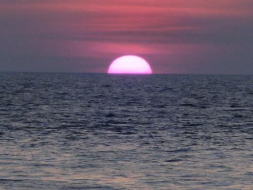 Sun dipping in the sea