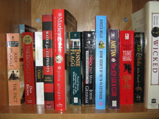 This is a tiny handful of the paperback books in my house. I cleaned this shelf up to take the shot!