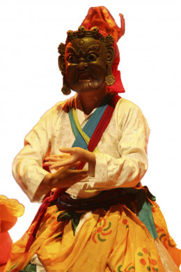 A masked dancer performing in public square