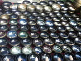 Singing bowls are sold in curio shops in Kathmandu. It is used in music meditation.