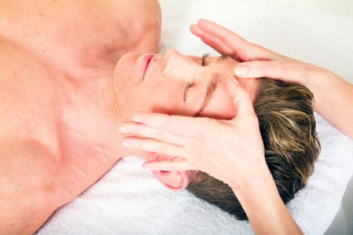 Giving a facial massage to others is best done working from behind your client as in the photograph.