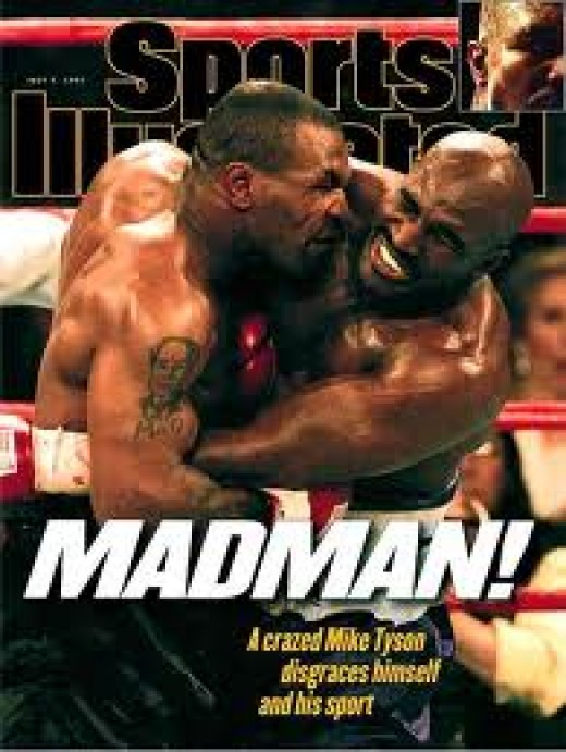 Mike Tyson is pictured on the cover of Sports Illustrated biting the ear of Evander Holyfield during his heavyweight title rematch.