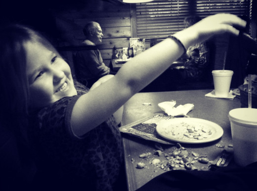 Our littlest one throwing a peanut shell at her Daddy.