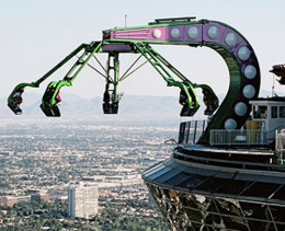 The recent add-on ride known as insanity hangs hundreds of feet above ground ready to spin.
