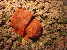 Cooked ground beef with sauce added
