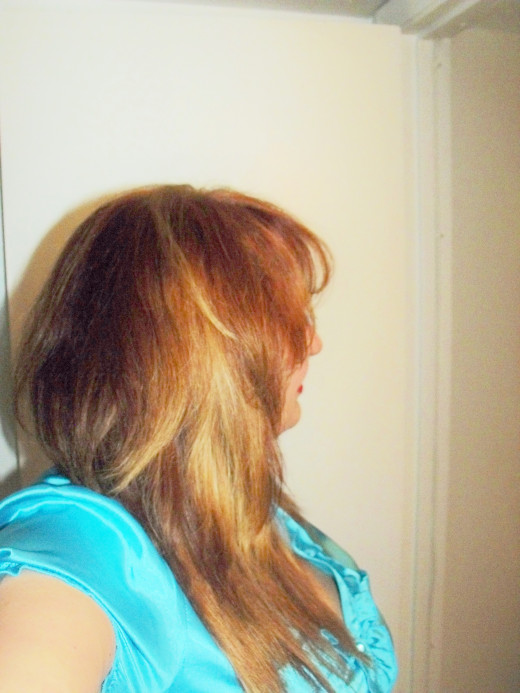 L'Oreal Excellence Creme Permanent - Medium Blonde #8.  Result:  Toned down the brass and quieted my loud red.