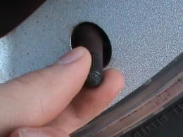 unscrewing dust cap