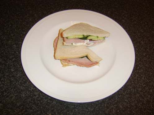 Cucumber, thick slices of honey roast ham and cottage cheese with onion and chive is just one of the cucumber sandwich recipe ideas featured on this page