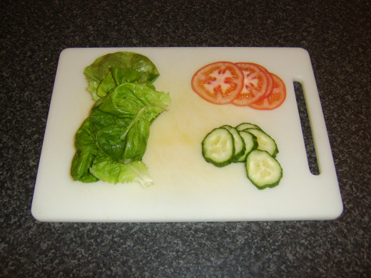 Lettuce, cucumber and tomato prepared for sandwich