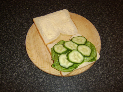 Cucumber slices are laid on top of lettuce