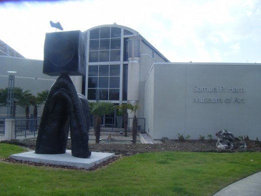 The Samuel P. Harn Museum of Art viewed from the approach.  The building is situated at the UF Cultural Plaza area in the southwest part of campus and is mainly focused on Asian, African, modern and contemporary art, plus photography.