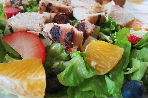 A healthy salad with simple ingredients and no dressing.  The berries, orange and chicken are delicious by themselves.