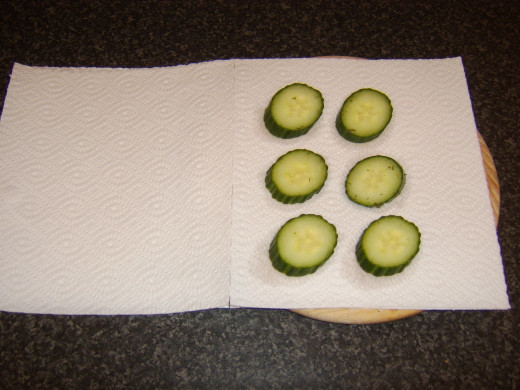Pickled cucumber is patted dry in kitchen paper