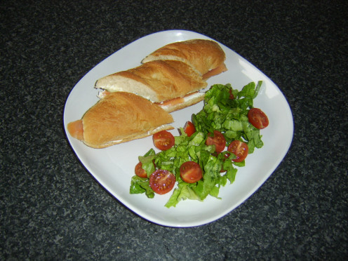 Pickled cucumber, smoked salmon and cream cheese sub served with a simple salad
