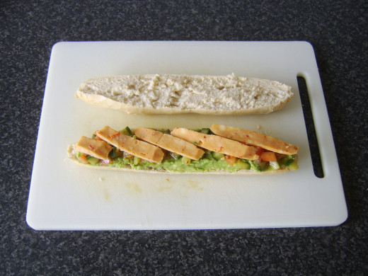 Mexicana cheese slices are laid on the avocado and cucumber salsa