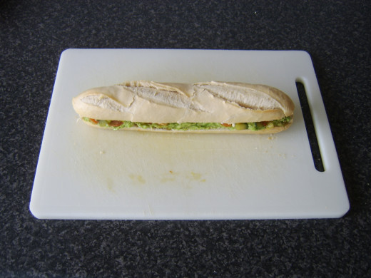 Baguette top is put in place prior to slicing