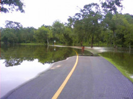 Flooding covers roadways, making them impassible.