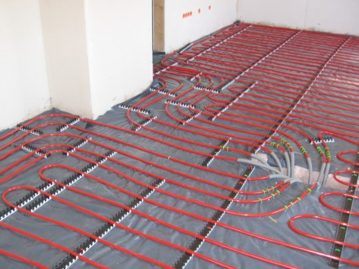 Underfloor heating using pipes filled with warm water.