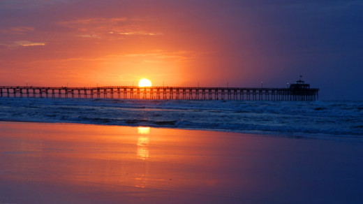 Don't you just love this photo of the pier at sunset. I love watching the sun go down over the ocean.