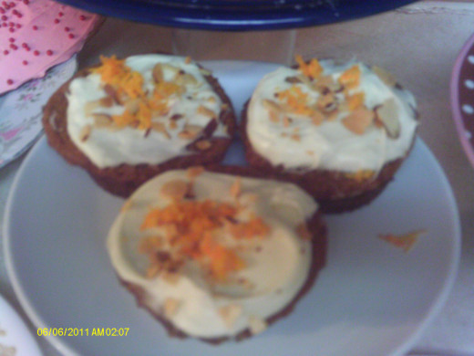 Orange Cranberry muffins with a Marscapone frosting and orange zest.
