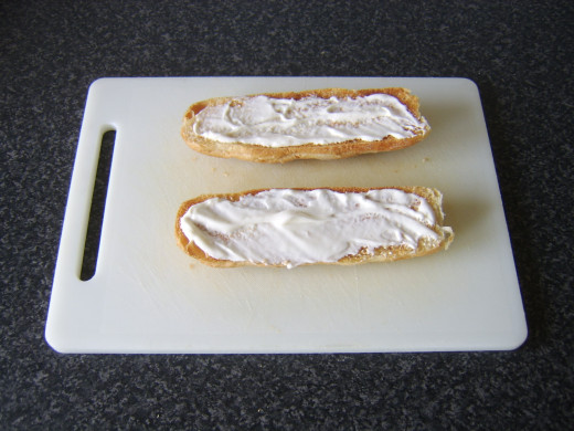 Mayo is spread on both halves of the toasted sub