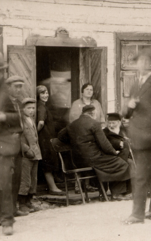 Meeting of 2 World Famous Rabbi's, Chafetz Chaim and Elchonon Wasserman at my Granny's house in Poland. My mom is the younger woman standing in the door-way.