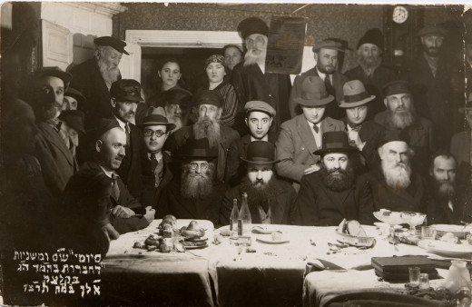 One-of-a-kind unique rare photo taken at my granny's house celebrating the completion of reading from the Torah 'a-page-a-day'. My granny and mom are standing at the back. In the front, on the extreme right is World renowned Rabbi Aharon Kotler.