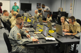 Students from the Brunswick Navy Junior Reserve Officer Training Course try out a virtual first-person shooter training program.