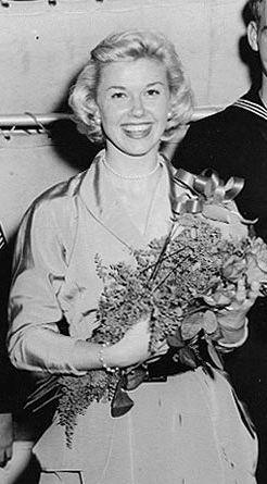 Doris Day, singer/actress/ dancer from 1940s to 1980s, the perennial blonde girl next door.