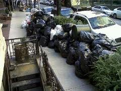 Trash piled up in front of people's homes.