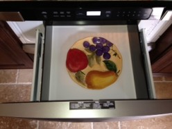 """The Sharp Microwave Drawer Oven is quite large, in fact more than large enough to hold a 9"""" x 13"""" oblong pan. I placed a dinner plate in our oven to illustrate the actual size. As you can see, there is plenty of room all around the 11"""" plate."""