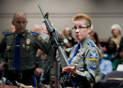 Firearms Training Unit Detective Barbara J. Mattson of the Connecticut State Police holds up a Bushmaster AR-15 rifle, the same make and model of gun used by Adam Lanza in the Sandy Hook School shooting...Photo: Jessica Hill