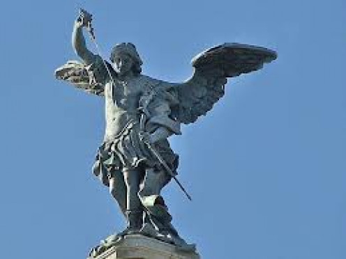 Saint Michael the Archangel is an Angel in Heaven. This statue shows him with a sword. Many monuments and statues celebrating Saint Michael.
