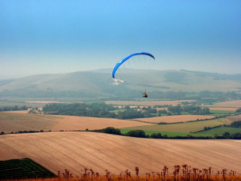 Paragliding is often a spectacle from this point. With views of Mount Caburn in the distance.